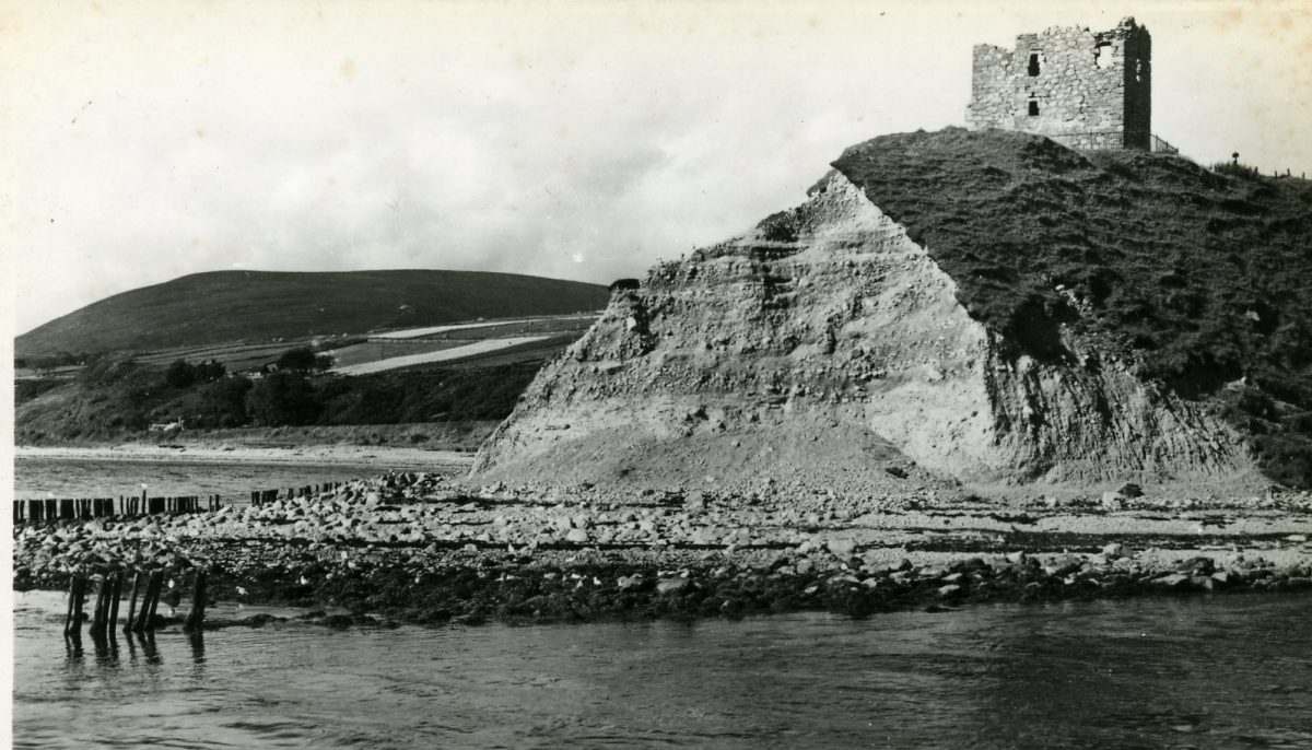 Ruins of Helmsdale Castle sitting above eroding coastline, dated c.1950s.